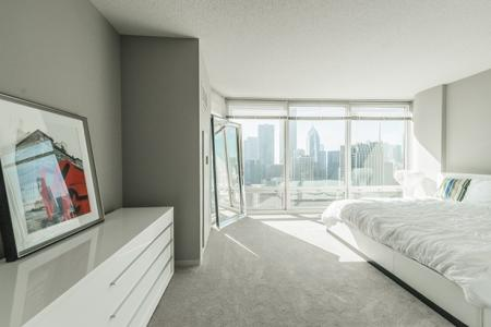 Spacious Master Bedroom | The Streeter Luxury Apartments